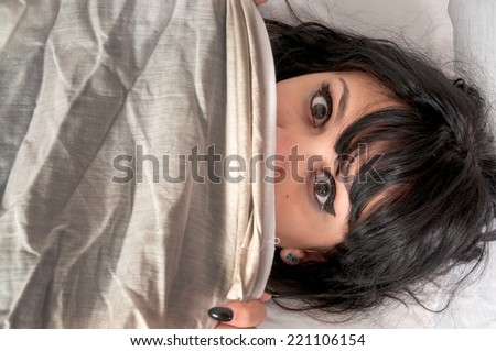 Woman waking up from a nightmare or night terror - stock photo
