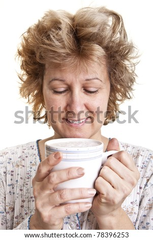 Woman waking up with a coffee (Looking at coffee)