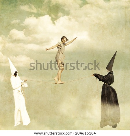 Woman walking along a tightrope held by two mysterious persons wearing white and black clothes - stock photo