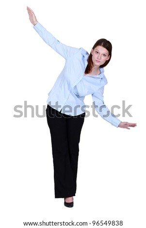 Woman walking along invisible tight-rope - stock photo