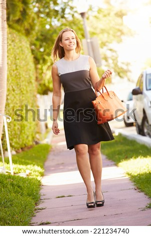 Woman Walking Along Street To Work - stock photo