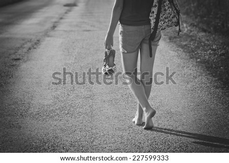 Woman walking away with a backpack
