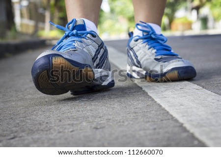 Woman walking cross country and trail - stock photo