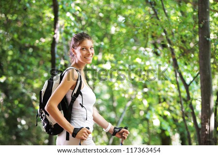 Woman walking cross country in forest