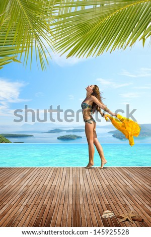 Woman walking on the edge of the swimming pool at luxury summer resort in Greece - stock photo