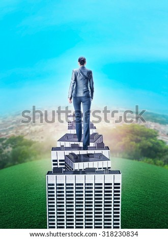 Woman walking on the roof of high building - stock photo