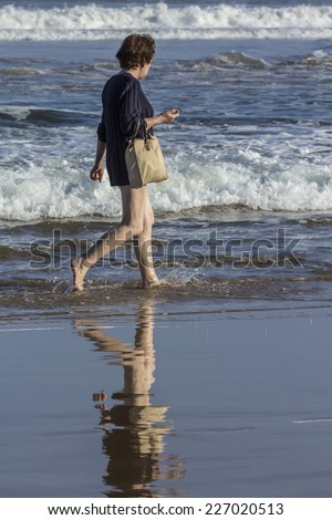 Woman walking on the seashore