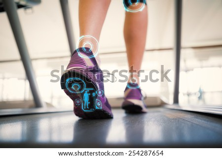 Woman walking on the treadmill against fitness interface - stock photo