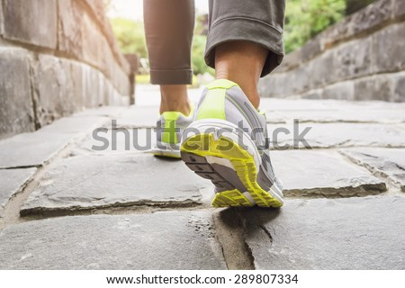 Woman Walking on trail Outdoor Jogging exercise  - stock photo