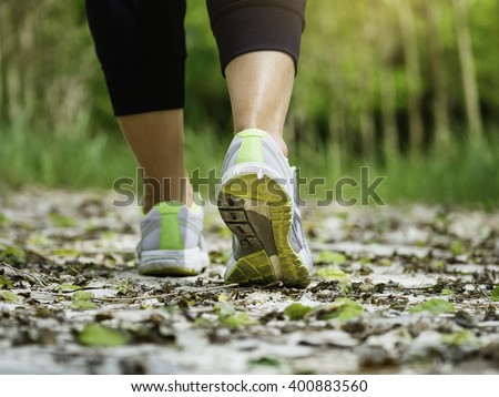 Woman Walking on trail Outdoor Jogging exercise Healthy lifestyle