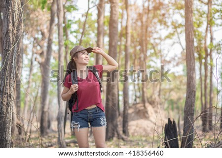Woman walking tour forest - stock photo