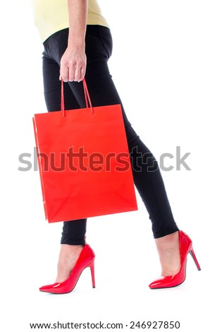 Woman walking with a shopping bag, isolated on white