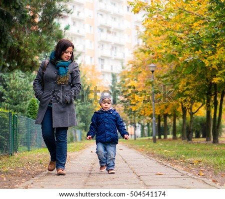 Woman walking with child on a footpath at a park