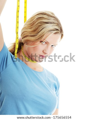 Woman want to hang her self on measuring tape - stock photo