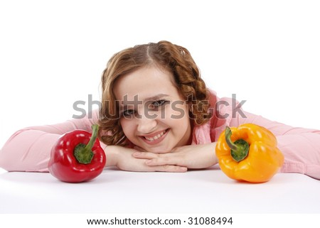 Woman wants to eat sweet peppers. Housewife with sweet peppers. Girl wants to eat sweet peppers.  Isolated over white background. - stock photo