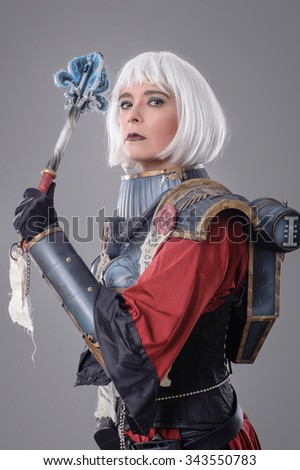 Woman warrior in battle armor. Isolated on the gray background