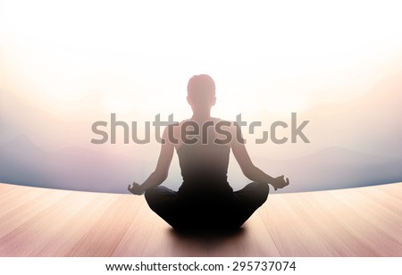 woman was meditating in morning and rays of light on landscape, vibrant soft and blur concept - stock photo