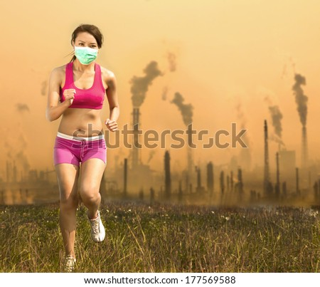Woman was wearing a mask and running  on air pollution   - stock photo