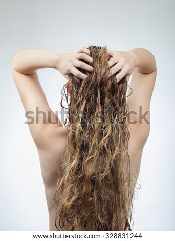 woman washes her beautiful hair