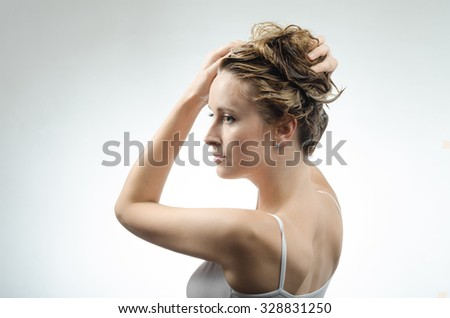 woman washes her beautiful hair - stock photo
