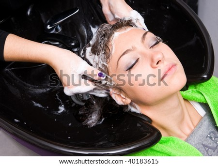 woman washing hair in hair salon