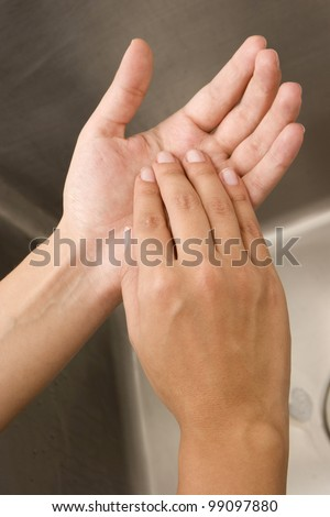 Woman Washing Hands Isolated - stock photo