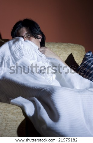 woman watching a halloween horror movie in the tv in a room - stock photo