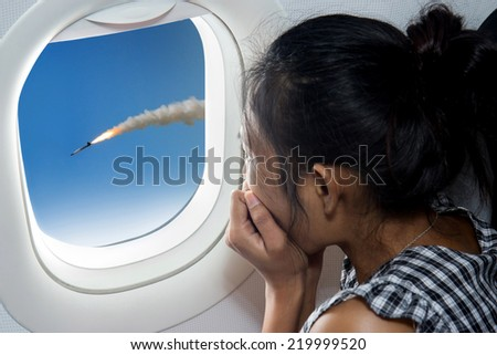 woman watching a rocket from airplane  - stock photo