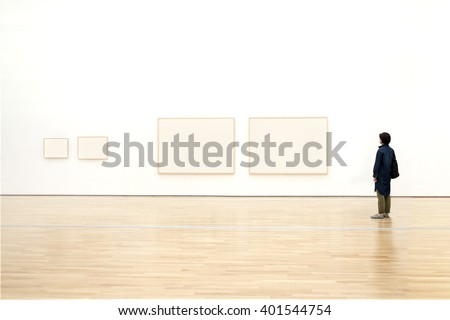 woman watching blank photo frame on wall art gallery, art exhibition  - stock photo