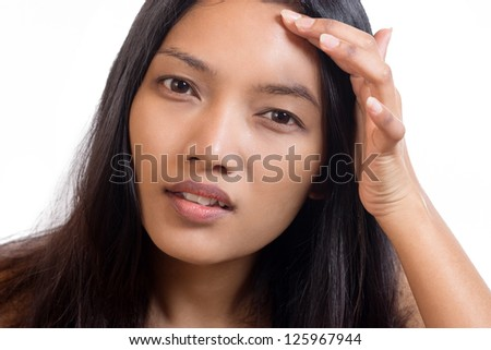 Woman watching her forehead - stock photo