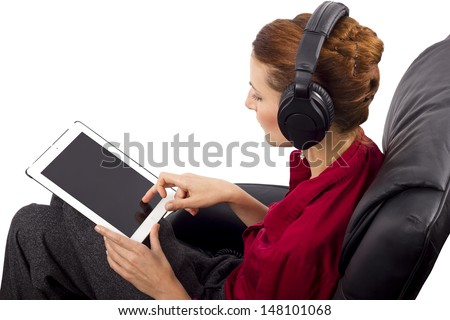 woman watching streaming programing on tablet - stock photo