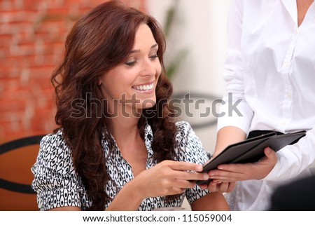 Woman watching the bill in a restaurant
