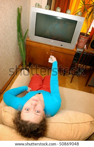 woman watching tv sitting on sofa