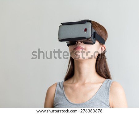 Woman wear with virtual eality headset - stock photo