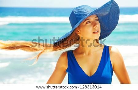 Woman wearing a hat - stock photo