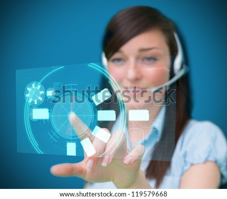 Woman wearing a head set while smiling using digital interface hologram