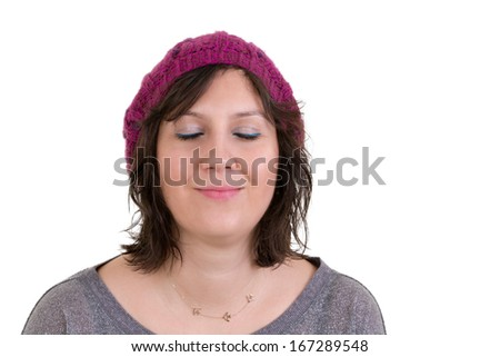 Woman wearing a purple knitted cap with an expression of pure bliss smiling in ecstasy with her eyes closed isolated on white - stock photo