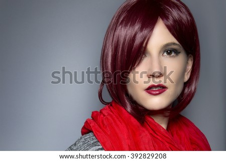 Woman wearing a stylish red neck scarf for fall or spring fashion
