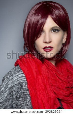 Woman wearing a stylish red neck scarf for fall or spring fashion - stock photo