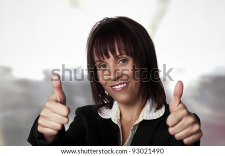 woman wearing a suit with her thumb's up
