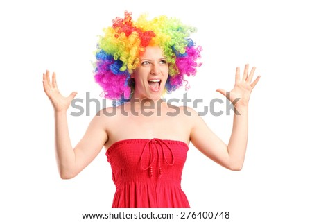 Woman wearing a wig and gesturing with hands isolated on white background - stock photo