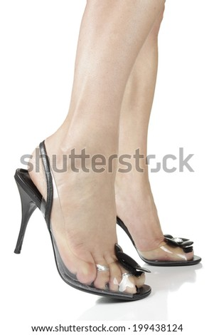 Woman wearing black  heels isolated over white background - stock photo