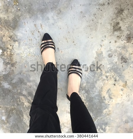 Woman wearing black pants and black high heel shoes in old town great for any use. - stock photo