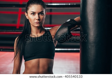 woman wearing boxing gloves near punching bag