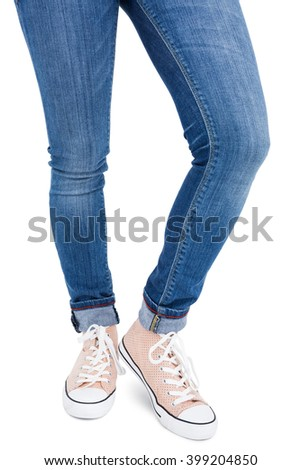 Woman wearing canvas shoes on white background