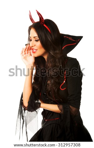 Woman wearing devil clothes whispering to someone.