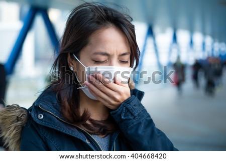 Woman wearing face mask - stock photo