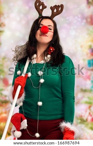 Woman wearing festive decorations and holding a mop ready for Christmas with colorful bokeh in the background.