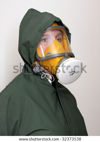 Woman wearing gas mask and protective suit. - stock photo