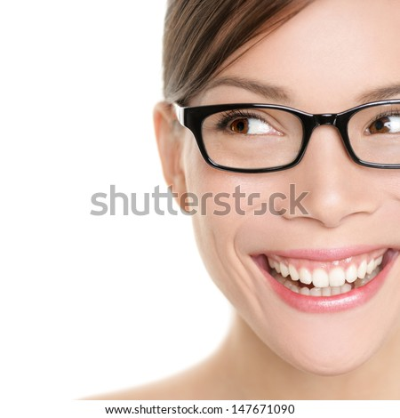Woman wearing glasses looking happy to side. Eyewear woman with big smile wearing eyeglasses. Close up portrait of female spectacles model isolated on white background. Mixed race Asian Caucasian girl - stock photo